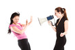 An angry businesswoman shouting toward her colleague