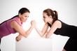 An shot of two businesswomen arm wrestling