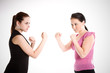 A shot of two businesswomen ready to fight