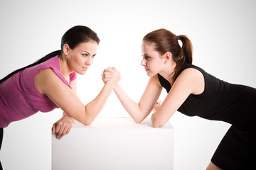 An shot of two businesswomen arm wrestling