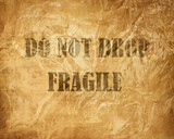 Fragile crate with warning letters written on it poster