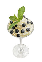 Blueberries with cream on white background.