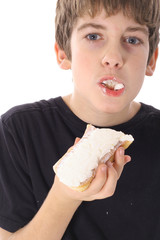 young boy eating a pastry