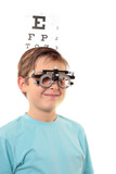 A boy with trial frames during a visit to the eye doctor poster