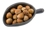 hazelnuts in shells on a wooden, primitive scoop poster