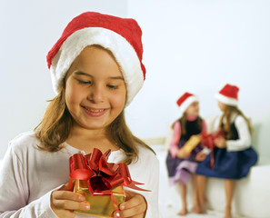 a little girl happy after reciving a present