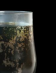 Cola Soft Drink in glass over black background