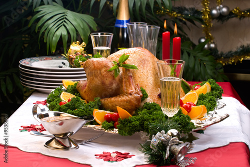 Garnished roasted turkey on Christmas decorated table