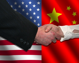 handshake over American and Chinese flags illustration