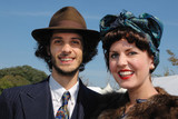 couple in fifties costume at Goodwood Revival, UK poster