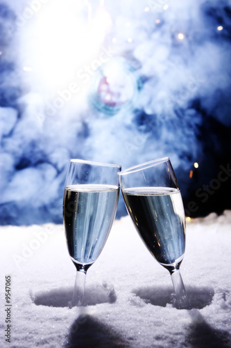 two champagne glasses in snow clink gla