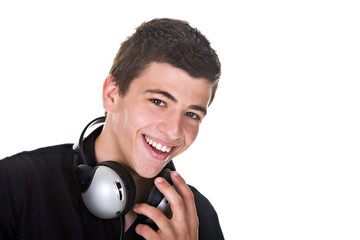 Portrait of a happy young man smiling, with headphones.