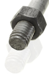 Close up of bolt and nut on white background