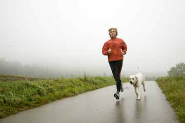 Road running with dog