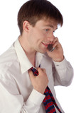 businessman speaks by emotionally to phone