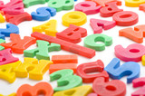 A group of colorful plastic alphabet letter magnets poster