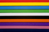 A stack of colorful foam, a mulit-colored  striped background poster