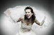 attractive happy bride over grey background