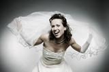 attractive happy bride over grey background