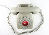 Old analog antique grey telephone with dial wheel, non digital poster