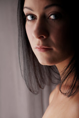 Naked young adult caucasian woman with black hair
