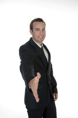 businessman offering handshake against white background