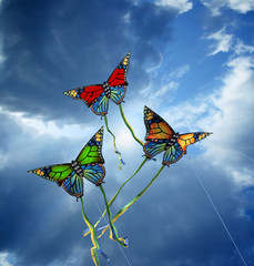 Three colorful kites at cloudy sky