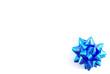 Blue shiny bow on the white background