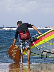 A young man getting ready to hit the waves