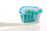 toothbrush with toothpaste isolated on white background poster