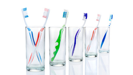 toothbrushes in glasses, isolated