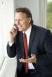 A happy businessmanon cellphone
