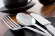 Knife, fork and spoon table setting in cafe - 9591498