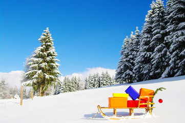 colorful presents on a sledge in a winter landscape.....