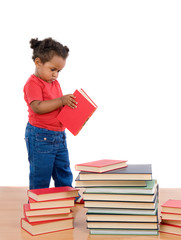 Adorable african baby reading with many pile of books