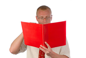 businessman looks  folder of red color with documents