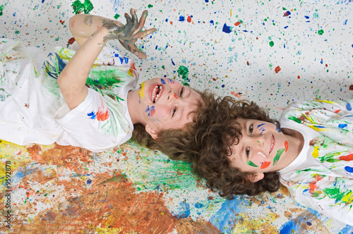 Fototapeta Children playing with painting with the background painted