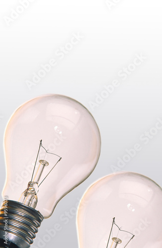 One electric lamp on  smooth surface on  grey background