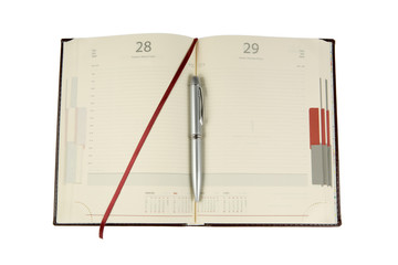 Notebook and ballpen isolated on a white background
