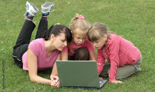Mom and daughters at laptop