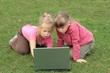 little girls staring at laptop
