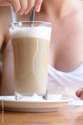 Woman enjoying her latte machiatto............