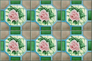 A row of antique nyonya tiles with pink rose