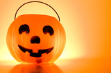 A Jack-O-Lantern trick or treat bucket ready for Halloween. poster
