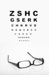 Eye glasses with test chart isolated. Ophthalmology  concept