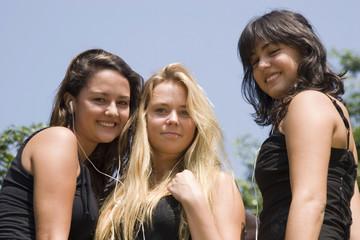Portrait of three teenagers enjoying outdoor