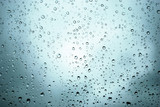 rain drops on a window and mystic silhouette of city poster