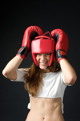 girl with red boxing gloves on a black background