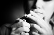 Smoking woman. Focus on cigarette lighter. - 9611811