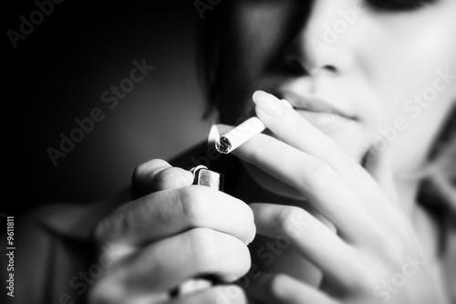 Smoking woman. Focus on cigarette lighter. - 9611811